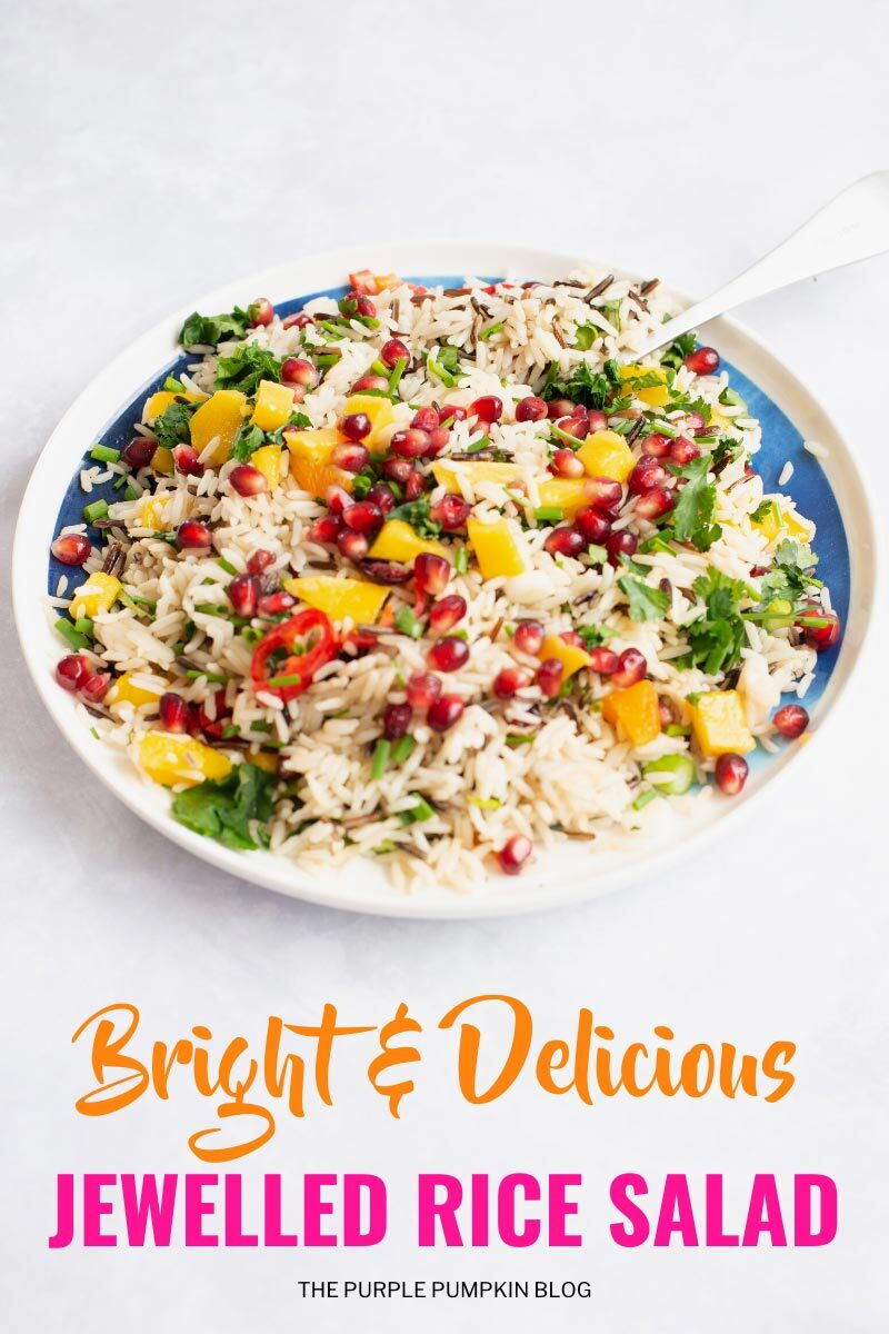 "A shallow bowl filled with rice salad - with fresh herbs, pomegranate, mango and red chilies. Text overlay says""Bright & Delicious Jewelled Rice Salad"". Similar photos of the recipe/dish from various angles are used throughout and with different text overlay unless otherwise described."