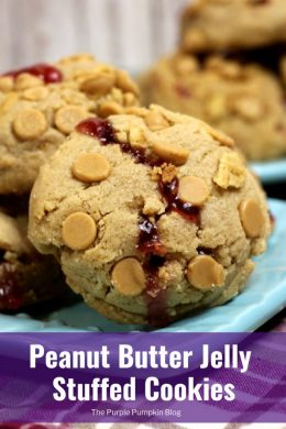 These Peanut Butter Jelly Stuffed Cookies are a must bake for peanut butter lovers everywhere! They take peanut butter cookies to the max with not only peanut butter as an ingredient, but the cookies are rolled in peanut butter chips,and Nutter Butters... Andthen, they are injected with delicious jam for the ultimate PB&J cookie! #PeanutButterCookies #PeanutButterJellyCookies #ThePurplePumpkinBlog
