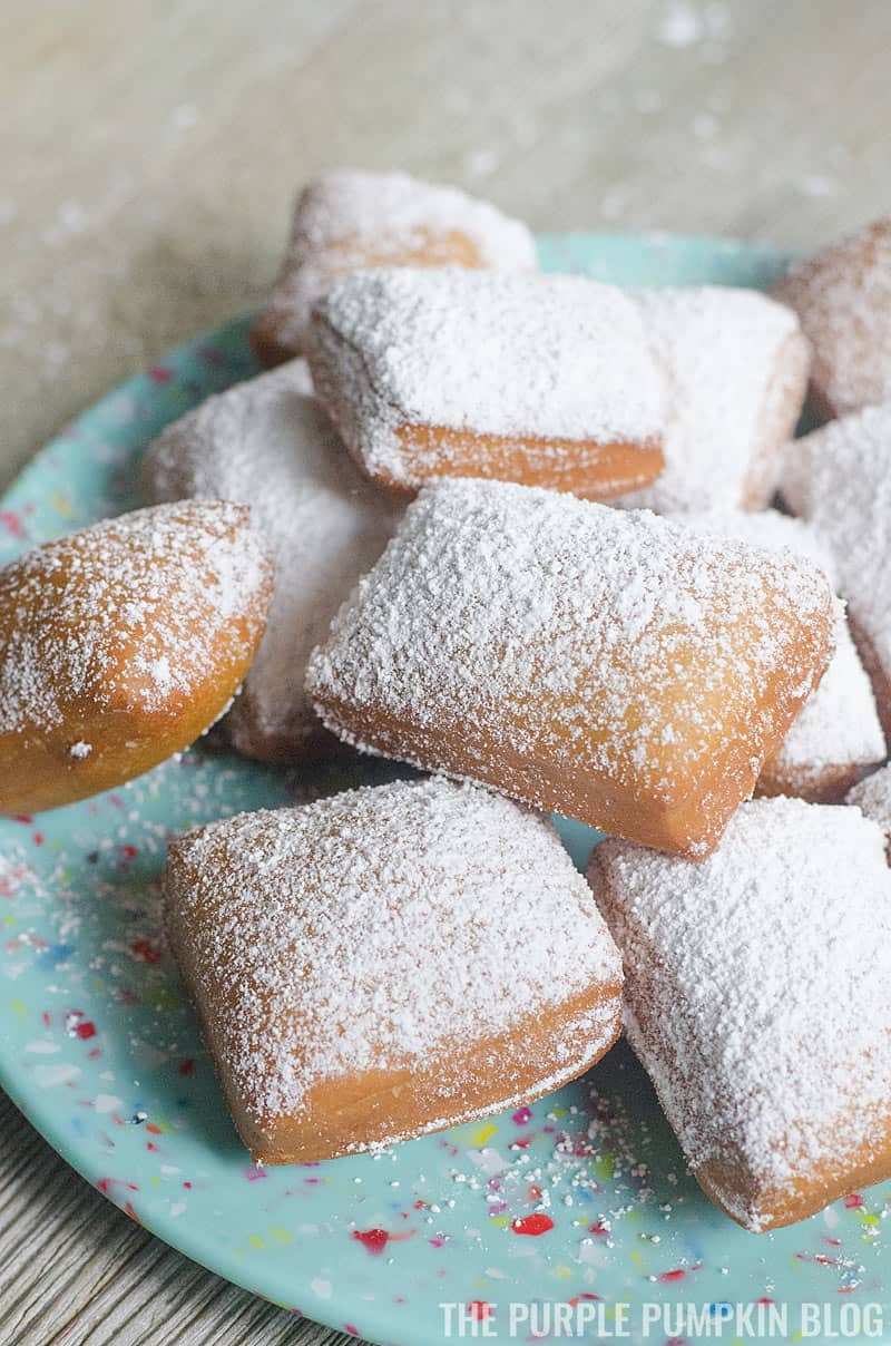 A plate stacked with beignets