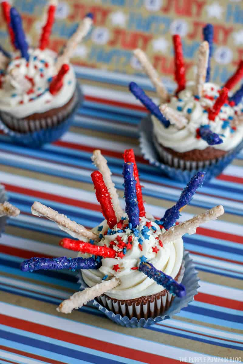 4th of July Fireworks Cupcakes with red, white and blue candy decorations and sprinkles.