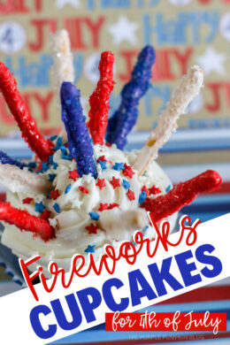 Fireworks Cupcakes for 4th of July. White frosted cupcakes with red, white, and blue star sprinkles, and candy coated pretzel sticks