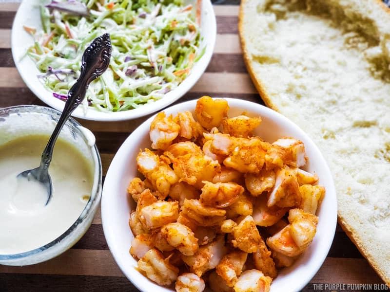 Bowl of shrimp, garlic lemon aioli, slaw mix and bread