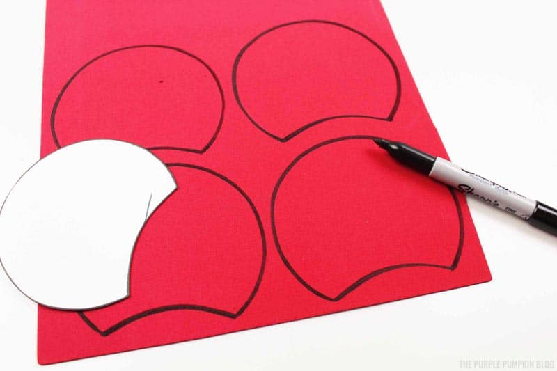 Trace around mickey ears on red