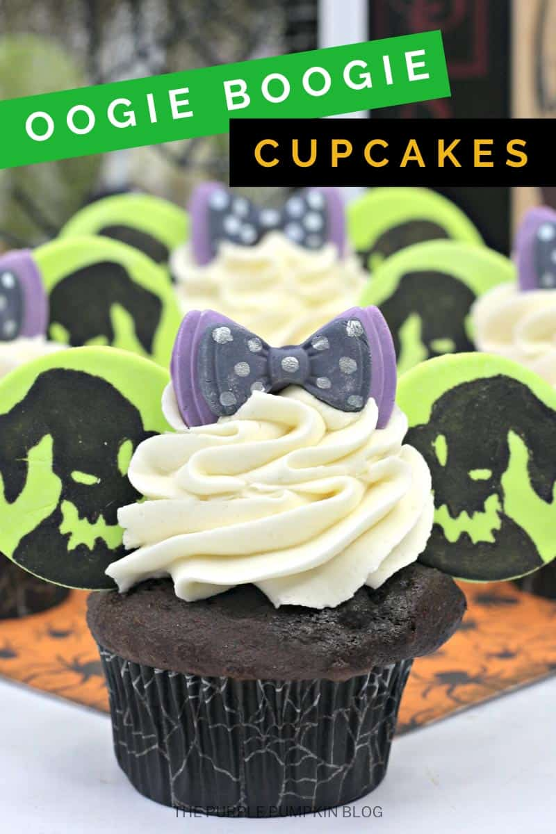 """Oogie Boogie Cupcakes - chocolate cupcake with white frosting, fondant""""Mickey Ears"""" with Oogie Boogies face drawn on, and a purple and black spotted fondant bow on top."""