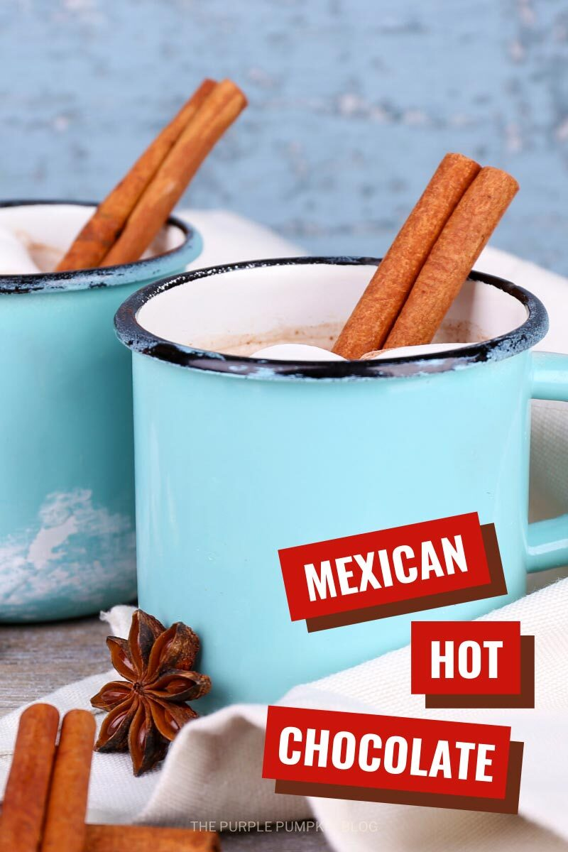 Spiced Mexican Hot Chocolate in blue mugs with a cinnamon stick