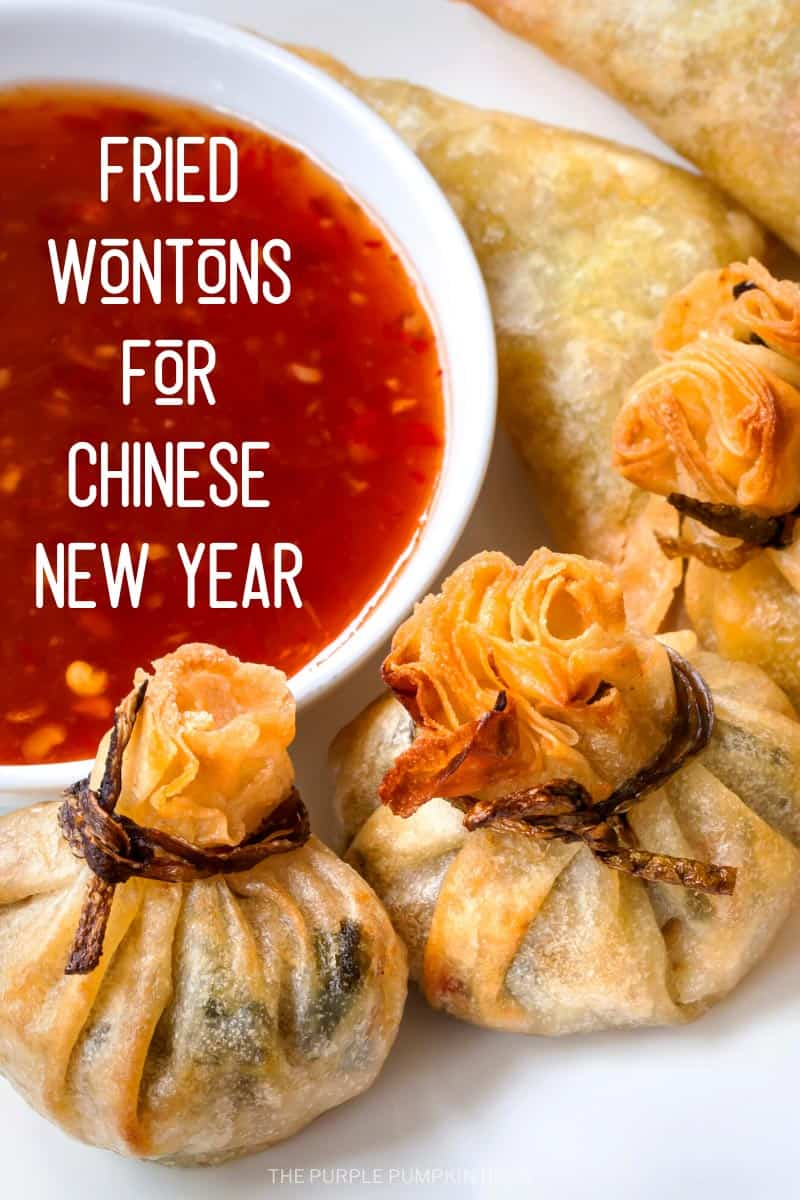A plate of fried wontons with chili dipping sauce