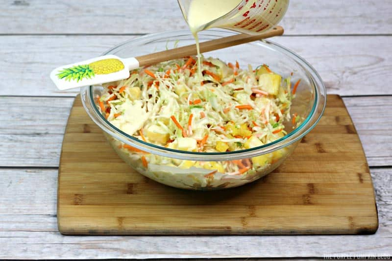 Pouring dressing on coleslaw