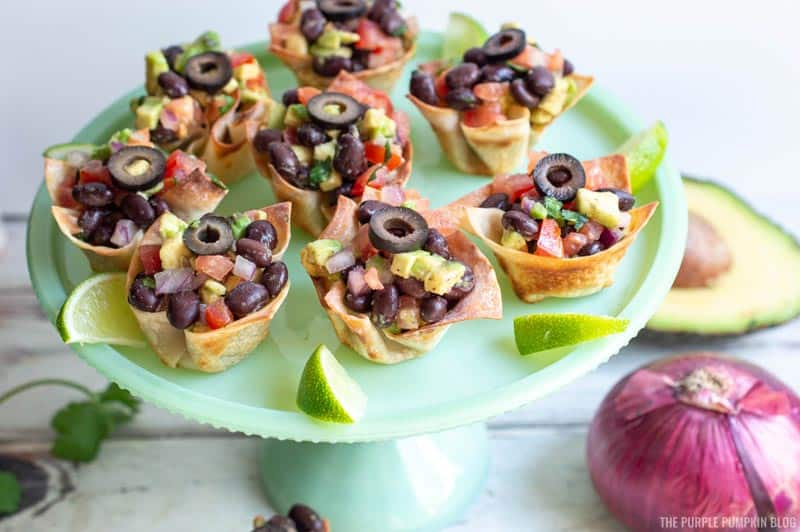 A plate of finished black bean salsa cups