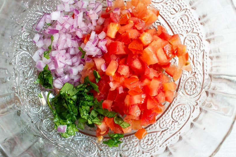 chopped tomato, red onion, and cilantro in bowl