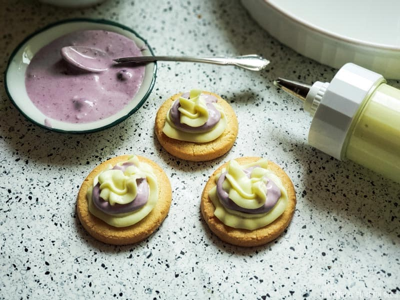 cookies topped with lemon and berry cheesecake mixture