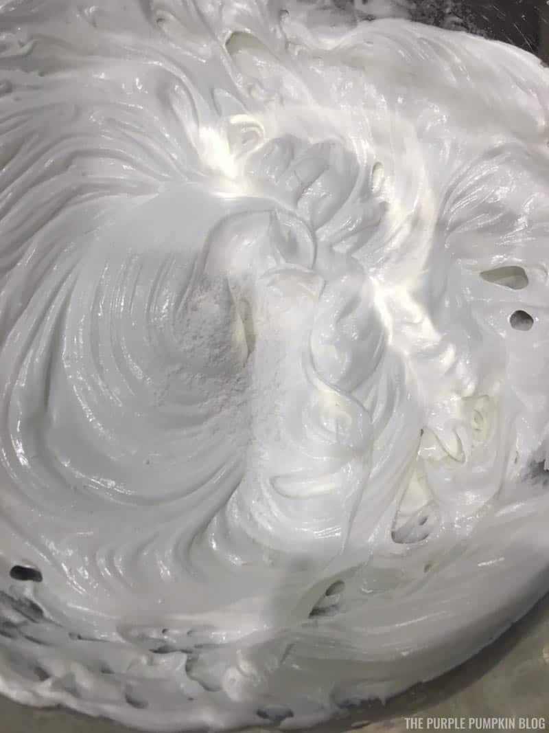 Adding cornstarch and cream of tartar to meringue mix