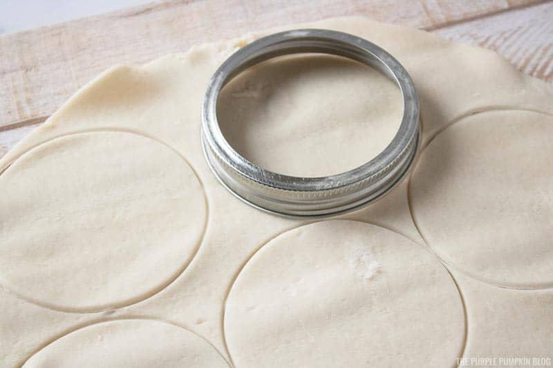 Cutting mini pumpkin pie crusts