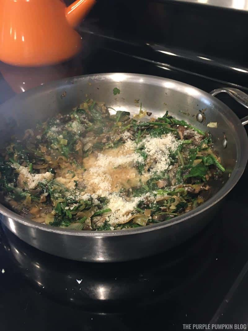 Adding Parmesan to sauteed mushrooms and spinach