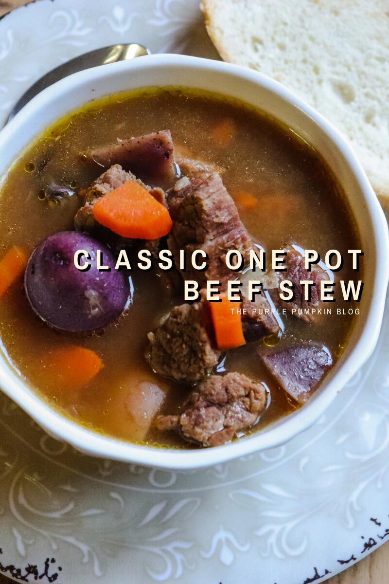 """A white bowl of beef stew with carrots add potatoes with a slice of bread on the side. Text overlay:""""Classic One Pot Beef Stew"""" Similar photos of the recipe/dish from various angles are used throughout and with different text overlay unless otherwise described."""