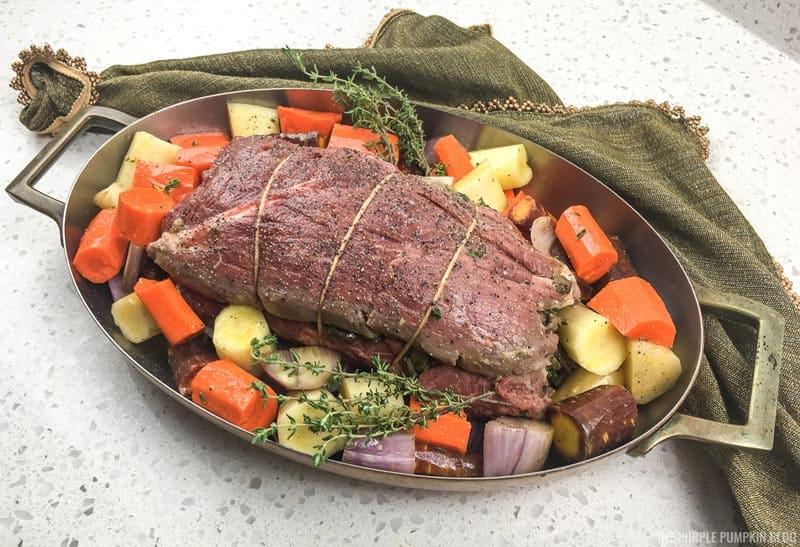 Vegetables placed around beef tenderloin