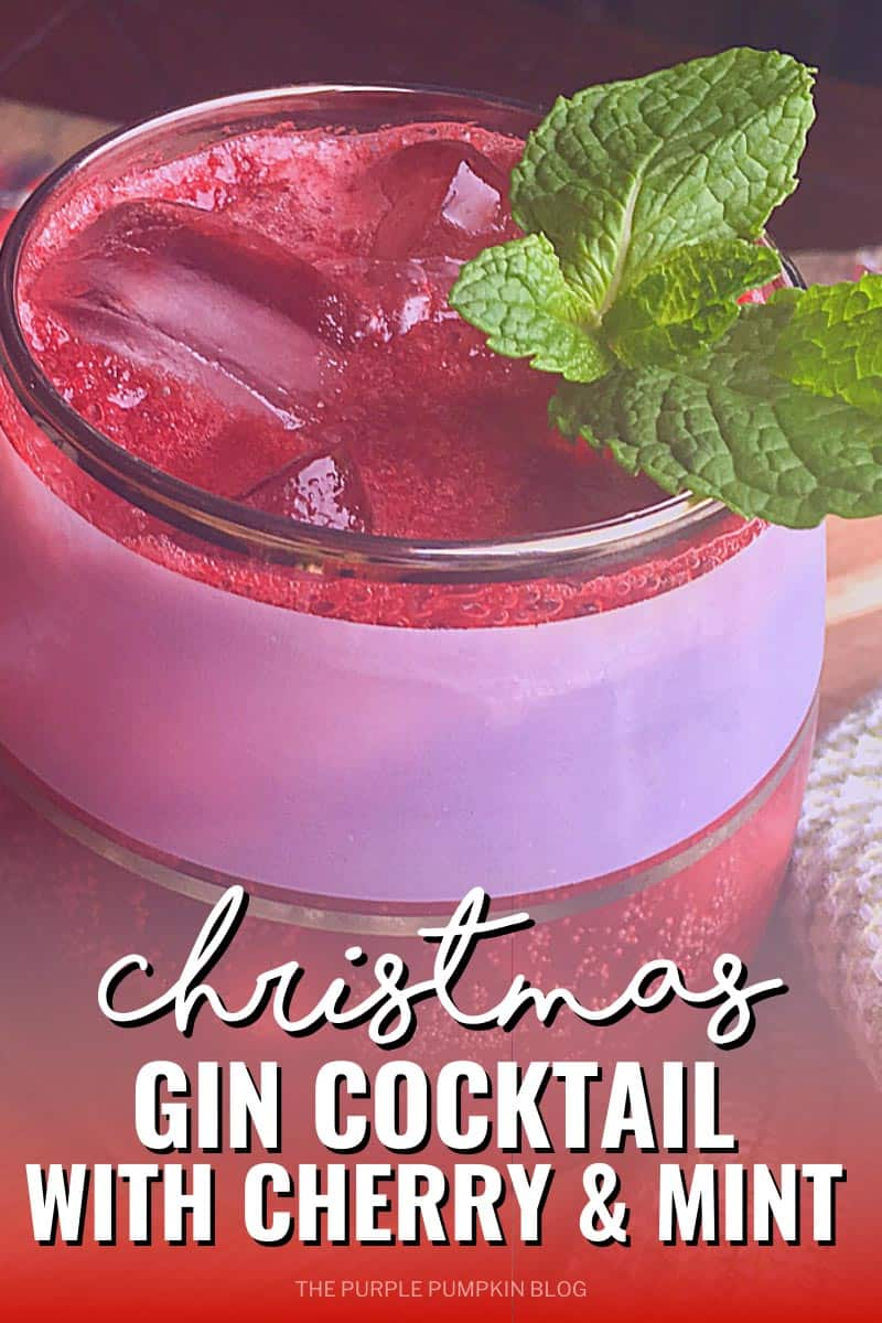 A glass filled with the red-colored cocktail, ice, and a mint sprig. Text overlay says