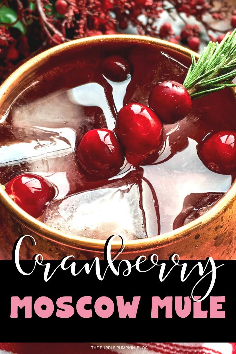 """Copper mug filled with the cocktail and garnished with cranberries speared onto a sprig of rosemary. The text overlay says""""Cranberry Moscow Mule"""". Images of the same cocktail featured throughout with different text overlay unless otherwise described."""