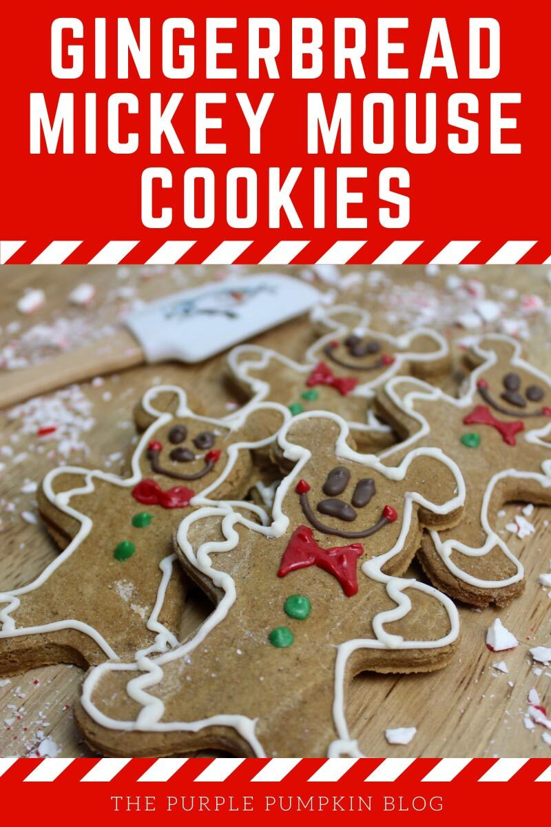 "Four Mickey Mouse-shaped gingerbread cookies on a wooden board surrounded by crushed candy canes and an Olaf spatula in the background. Text overlay says""Gingerbread Mickey Mouse Cookies"". Similar photos of the recipe/dish from various angles are used throughout and with different text overlay unless otherwise described."