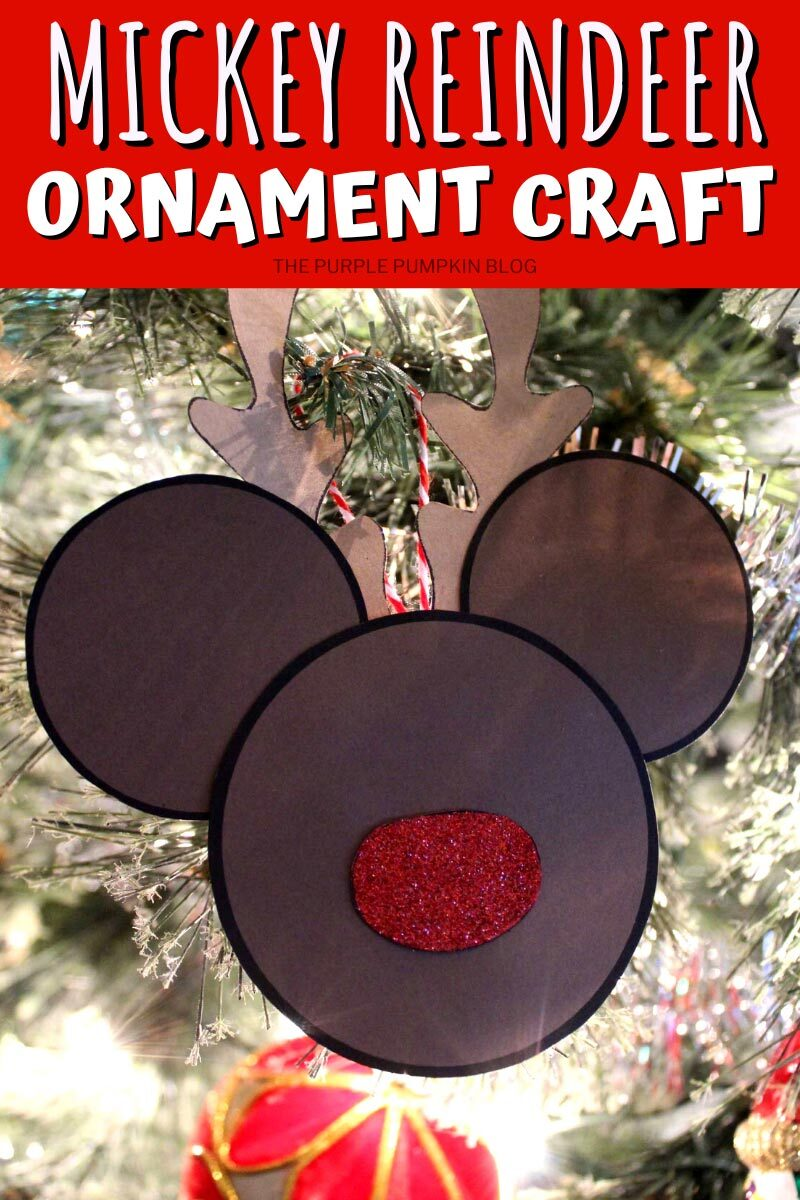 Paper Reindeer Mickey Mouse Ornament hanging in a Christmas tree.