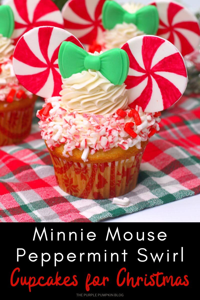 """A cupcake topped with vanilla frosting and crushed candy canes, with peppermint swirl Minnie Mouse""""ears"""" and a green fondant bow. Text overlay says""""Minnie Mouse Peppermint Swirl Cupcakes for Christmas"""" Same cupcake featured throughout with different text overlay unless otherwise described."""
