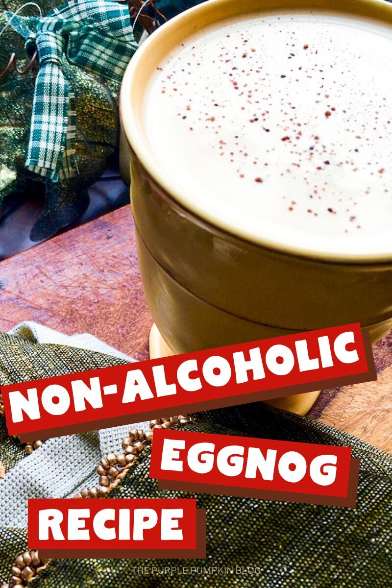 """A cream-colored mug filled with eggnog and sprinkled with nutmeg sat on a wooden board with green holiday decorations in the background. Text overlay says""""Non-Alcoholic Eggnog"""". Images of the same drink featured throughout with different text overlay unless otherwise described."""