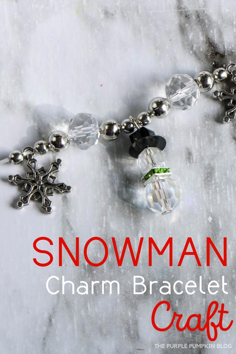 """Close up of a charm bracelet made with beads, snowflake charms and snowman charms. Text overlay says""""Snowman Charm Bracelet Craft"""". Similar photos of the craft from various angles are used throughout with different text overlay unless otherwise described."""