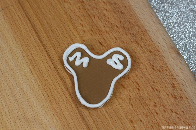 Piping on Gingerbread Mickey Head