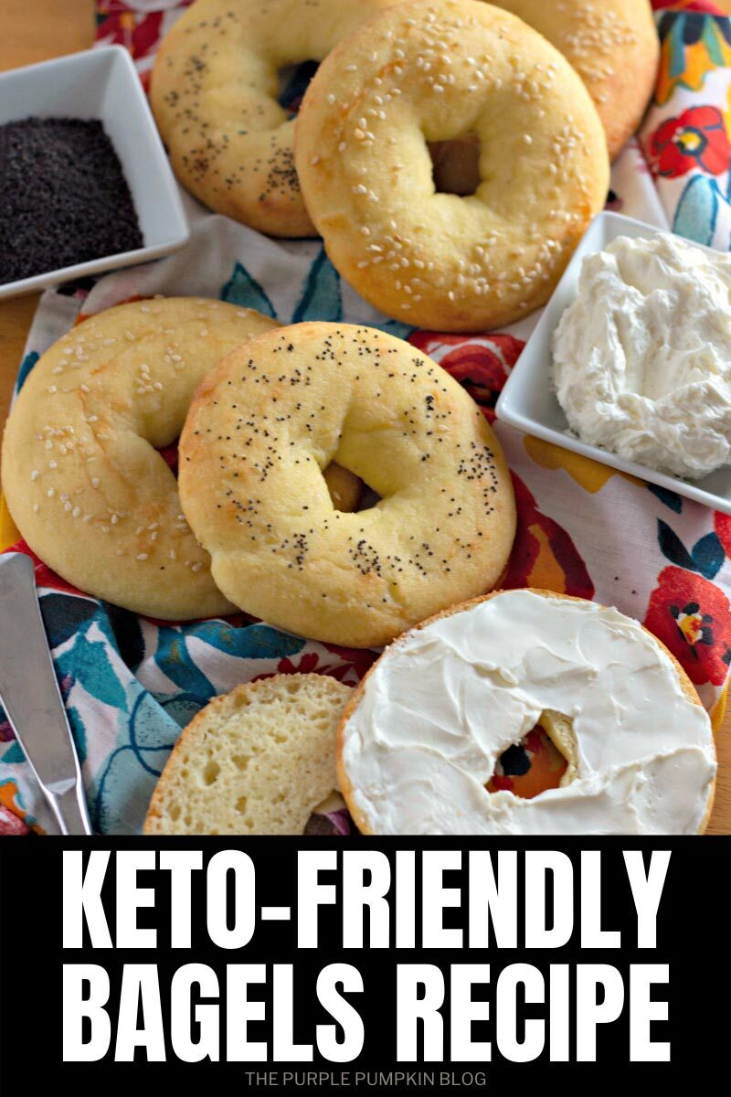 "Several fat head bagels sat on a cloth. One is cut in half and spread with cream cheese. Text overlay says""Keto-Friendly Bagels Recipe"". Similar photos of the recipe from various angles are used throughout but with different text overlay unless otherwise described."