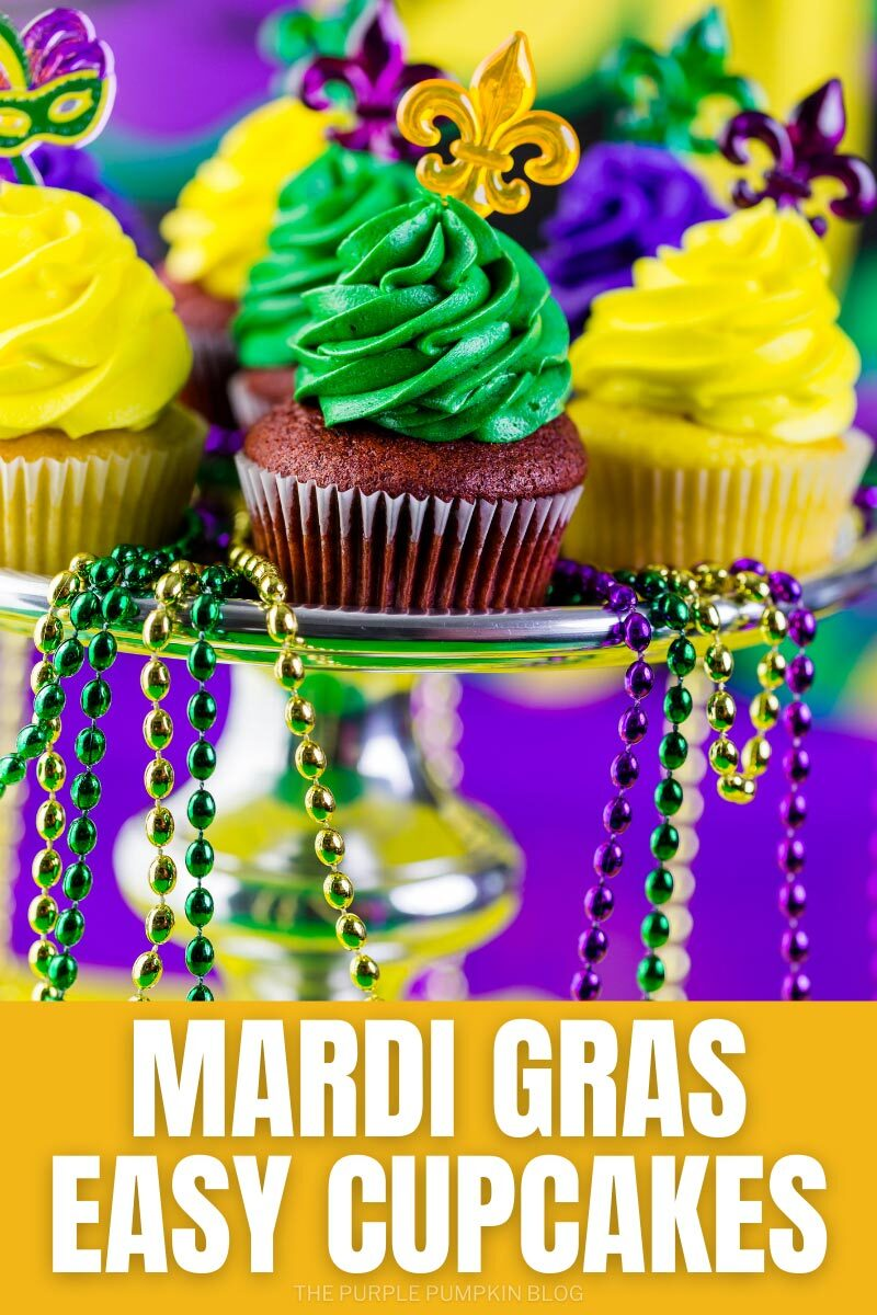 """A cake stand with vanilla and chocolate cupcakes frosted in purple, green, or yellow frosting, and Mardi Gras beads hanging from the sides of the stand. Text overlay says""""Easy Mardi Gras Cupcakes"""". Similar images of the cupcakes with different text overlay used throughout unless otherwise described,"""
