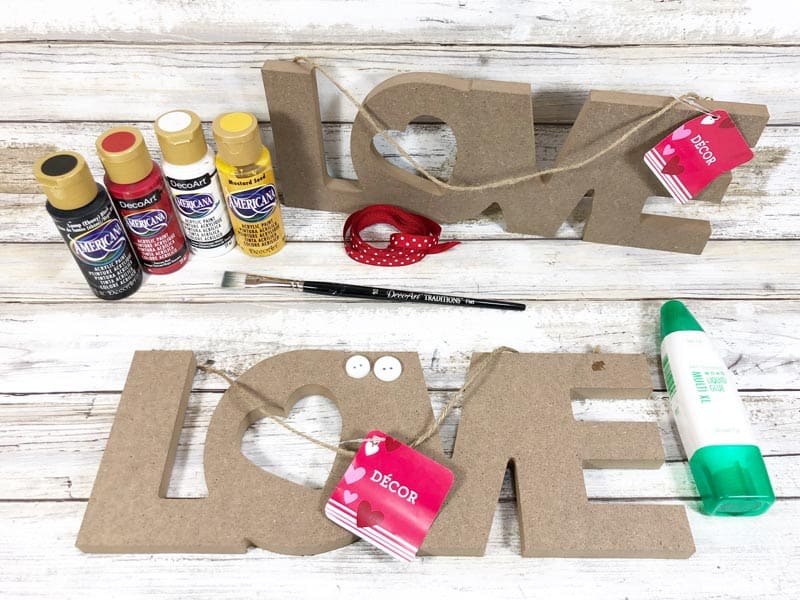 Mickey & Minnie Love Sign Craft Supplies - two LOVE signs, bottles of paint, glue, paintbrush, ribbons and buttons.