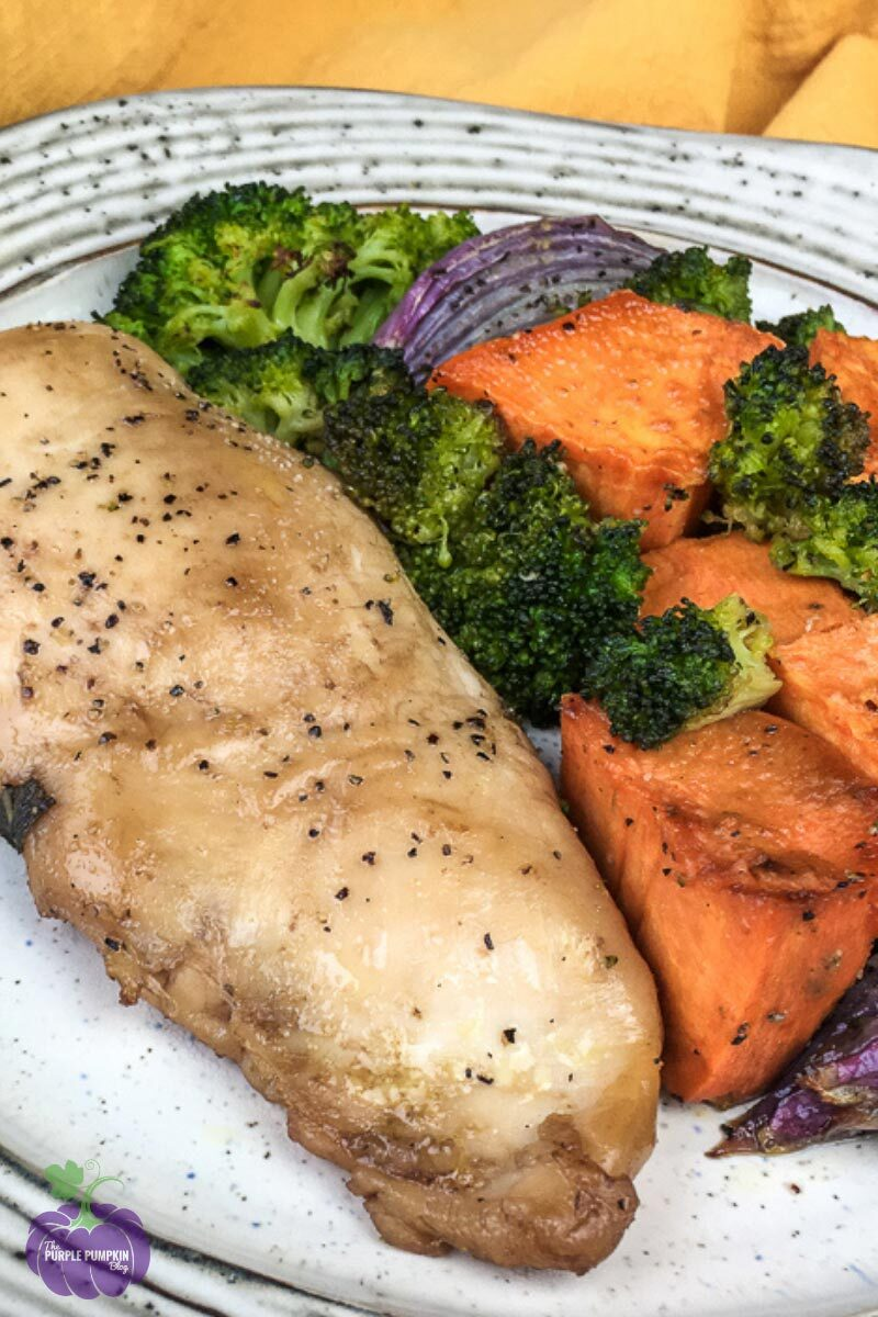 Balsamic Chicken Breast served with sweet potato and broccoli on the side, on a white plate.