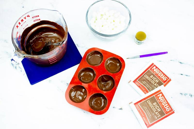 Adding Melted Chocolate to Molds