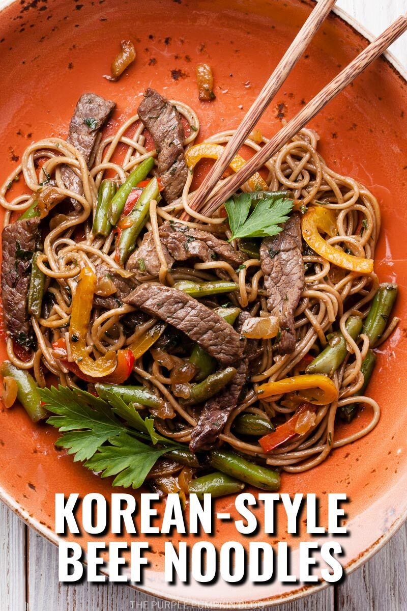 "An orange plate filled with noodles, strips of beef, and vegetables, with chopsticks. Text overlay says""Korean-Style Beef Noodles"". Similar photos of the recipe/dish from various angles are used throughout and with different text overlay unless otherwise described."
