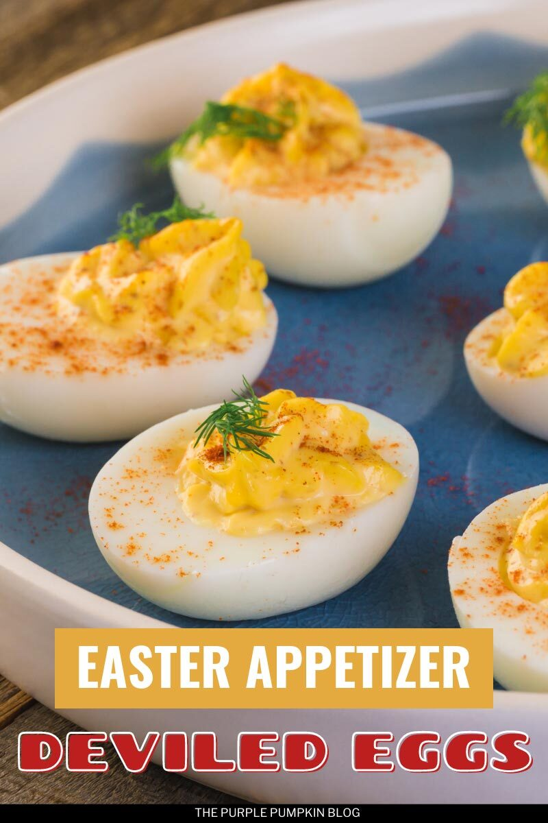 """A blue plate with several Deviled Eggs topped with paprika and dill. Text overlay says""""Deviled Eggs Easter Appetizer"""". Similar photos of the recipe from various angles are used throughout but with different text overlays unless otherwise described."""