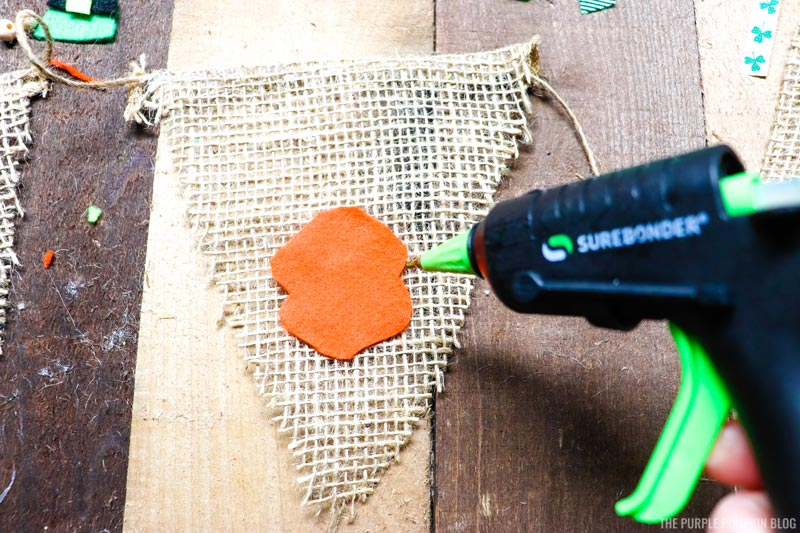Gluing Gnome Pieces onto Burlap