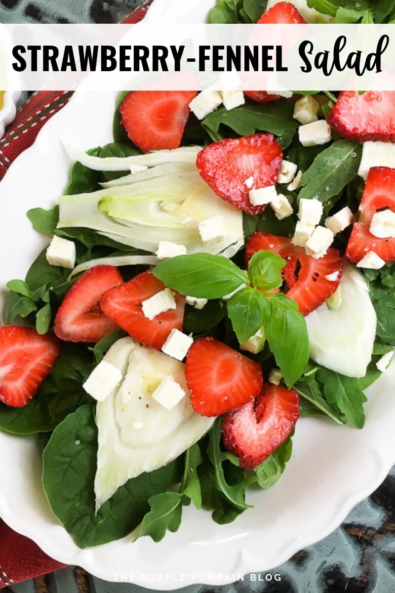 """A platter filled with arugula, fennel, strawberry, and feta salad. Text overlay says""""Strawberry-Fennel Salad"""". Similar photos of the recipe from various angles are used throughout but with different text overlays unless otherwise described."""