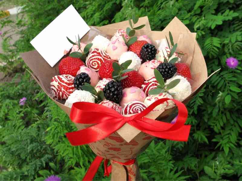 a bouquet of chocolate truffles and strawberries.